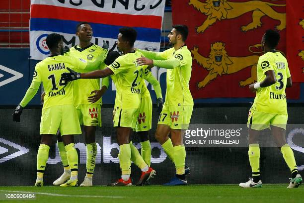 Lille's Portuguese forward Rafael Leao celebrates with teammates after scoring a goal during the French L1 football match between Caen and Lille on...
