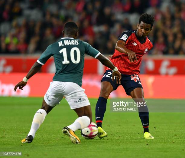 Lille's Portuguese midefielder Thiago Mendes vies with Nantes' Ghanaian forward Majeed Waris during the French L1 football match between Lille and...