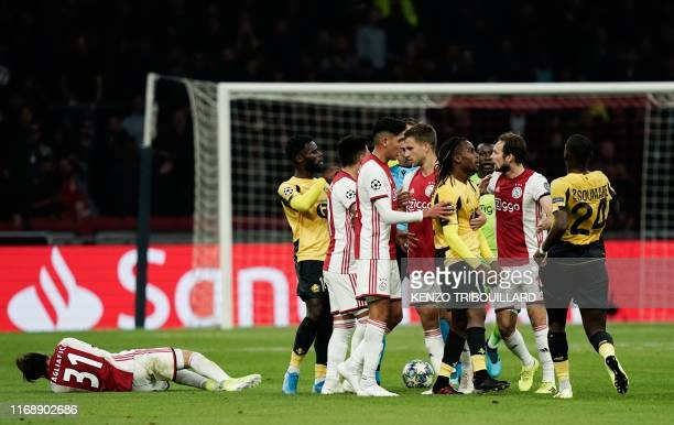 Lille's Portuguese midfielder Renato Sanches reacts as he receives a yellow card by Serbian referee Srdjan Jovanovic next to Ajax's Argentine...