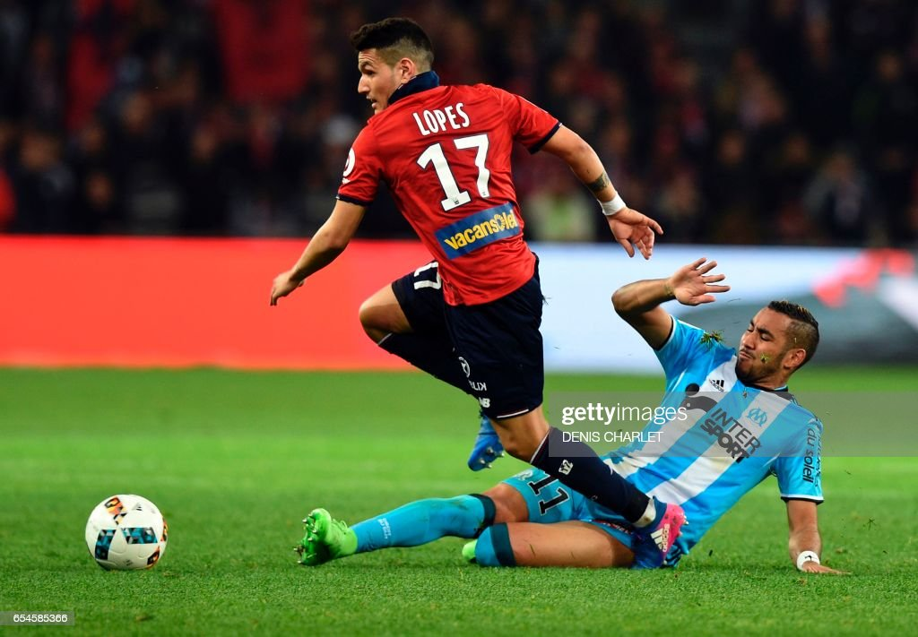 Lille's Portuguese midfielder Rony Lopes (L) vies with Olympique de Marseille's French forward Dimitri Payet during the French L1 football match between Lille OSC (LOSC) and Marseille on March 17, 2017 at the Pierre-Mauroy Stadium in Villeneuve d'Ascq, near Lille, northern France. CHARLET