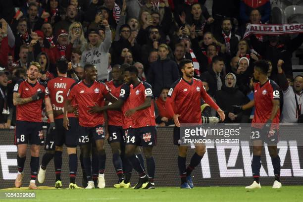 Lille's Raphael Alexandre Da Conceicao Leao celebrates with teammates after scoring a goal during the French L1 football match between Lille and Caen...