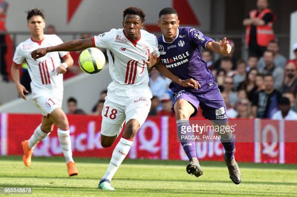 Lille's South Africa forward Lebo Mothiba vies with Lille's Toulouse's French defender Kelvin Amian during the French L1 football match Toulouse...