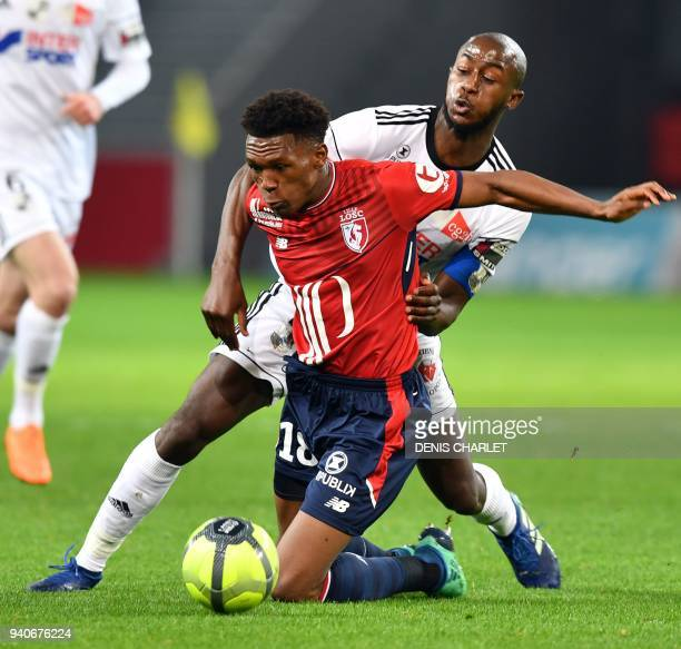 Lille's South African forward Lebo Mothiba vies with Amiens' French defender PrinceDesir Gouano during the French L1 football match played behind...
