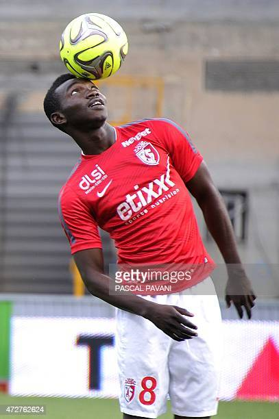 Lille's Spanish midfielder Adama Traore warms up before during the French L1 football match Toulouse against Lille on May 9 2015 at the Municipal...