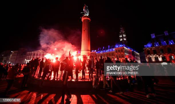 Lille's supporters celebrate after winning the French L1 title downtown Lille on May 23, 2021. - Lille won the Ligue 1 title over Angers which...