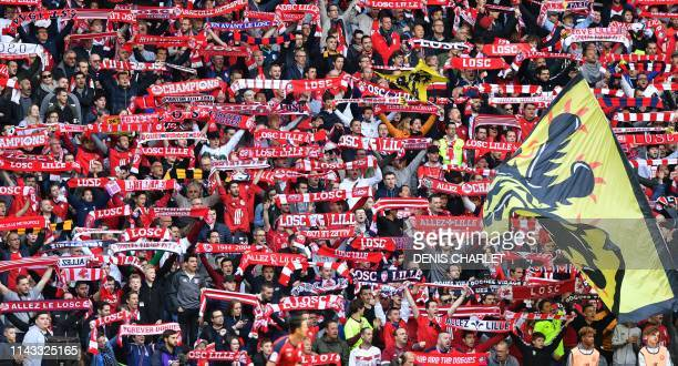 Lille's supporters cheer for their team during the French L1 football match between Lille OSC and Bordeaux at the Pierre-Mauroy Stadium in Villeneuve...