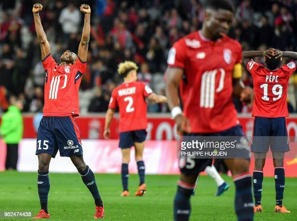 Lille's team players celebrate at the end of the French L1 football match between Lille and Metz on April 28 2018 at the Pierre Mauroy Stadium in...