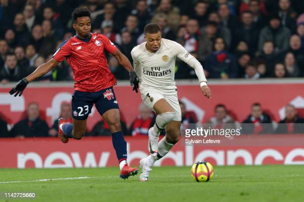 Lille's Thiago Mendes fights for the ball with Kylian Mbappe of Paris during the Ligue 1 match between Paris Saint Germain and Lille OSC at Stade...
