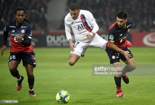 Lille's Turkish defender Zeki Celik vies for the ball with Paris SaintGermain's French forward Kylian Mbappe during the French L1 football match...