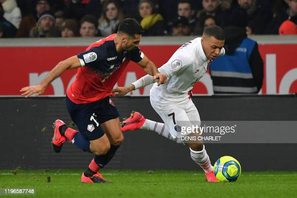 Lille's Turkish defender Zeki Celik vies with Paris SaintGermain's French forward Kylian Mbappe during the French L1 football match between Lille and...