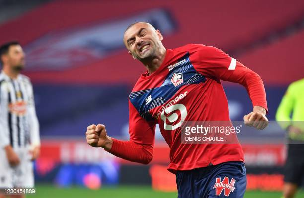 Lille's Turkish forward Burak Yilmaz celebrates after scoring a goal during the French L1 football match LOSC Lille and Angers SCO at The...