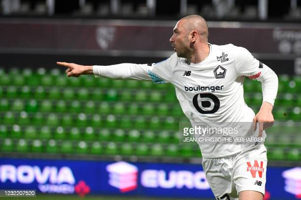 Lille's Turkish forward Burak Yilmaz celebrates after scoring a goal during the French L1 football match between Metz and Lille at Saint Symphorien...