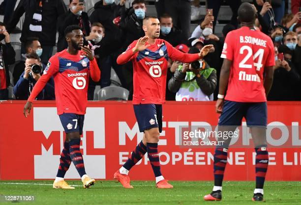 Lille's Turkish forward Burak Yilmaz celebrates after scoring a penalty during the French L1 football match between Lille OSC and FC Nantes at the...