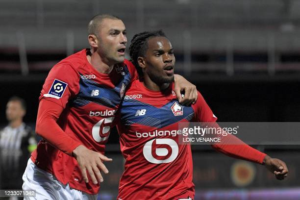 Lille's Turkish forward Burak Yilmaz celebrates with Lille's Portuguese midfielder Renato Sanches after scoring a goal during the French L1 football...