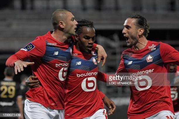 Lille's Turkish forward Burak Yilmaz celebrates with Lille's Portuguese midfielder Renato Sanches and Lille's Turkish midfielder Yusuf Yazici during...