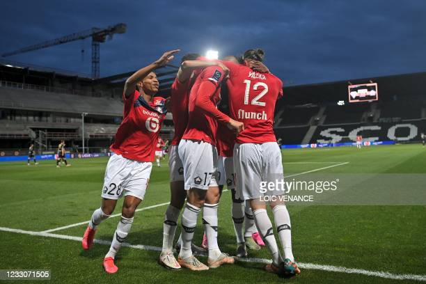 Lille's Turkish forward Burak Yilmaz celebrates with teammates after scoring a penalty kick during the French L1 football match between Angers SCO...