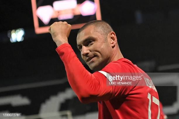 Lille's Turkish forward Burak Yilmaz gestures during the French L1 football match between Angers SCO and Lille OSC at The Raymond-Kopa Stadium in...