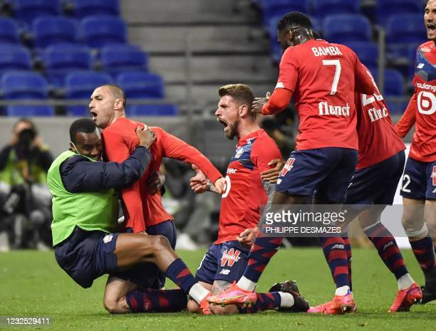 Lille's Turkish forward Burak Yilmaz is congratuled by teammates after scoring during the French Ligue 1 football match between Olympique Lyonnais...