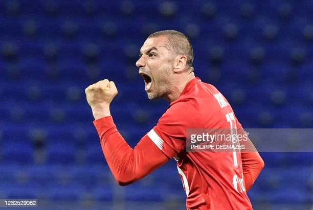Lille's Turkish forward Burak Yilmaz reacts after scoring during the French Ligue 1 football match between Olympique Lyonnais and LOSC Lille at the...