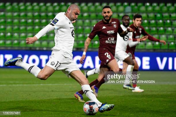 Lille's Turkish forward Burak Yilmaz shoots and scores a goal during the French L1 football match between Metz and Lille at Saint Symphorien stadium...