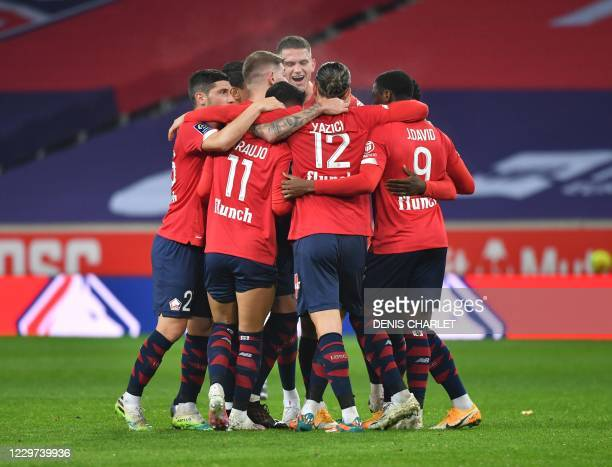 Lille's Turkish midfielder Yusuf Yazici celebrates a goal with his teammates during the French L1 football match between Lille OSC and FC Lorient at...