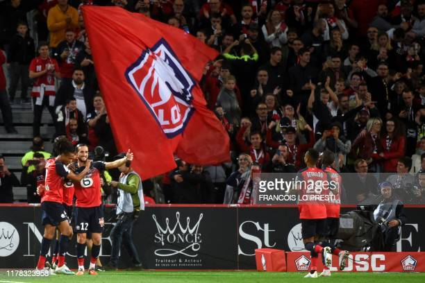 Lille's Turkish midfielder Yusuf Yazici celebrates with teammates after scoring a goal during the French L1 football match between Lille LOSC and FC...
