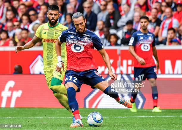 Lille's Turkish midfielder Yusuf Yazici vies with Nantes' Brazilian defender Lucas Lima during the French L1 football match between Lille and FC...