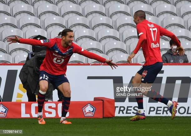 Lille's Turkish miedfielder Yusuf Yazici and Lille's forward Burak Yilmaz jubilate after scoring a goal during the French L1 football match between...