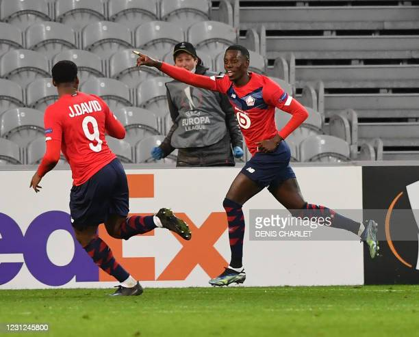 Lille's US forward Tim Weah celebrates scoring his team's first goal during the UEFA Europa League round of 32 first leg football match between Lille...