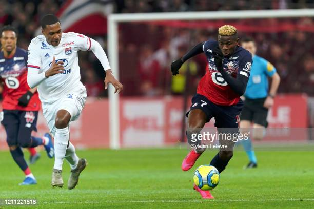 Lille's Victor Osimhen and Lyon's Marcelo during the Ligue 1 match between Lille and Lyon at Grand Stade Lille Métropole on March 08, 2020 in Lille,...
