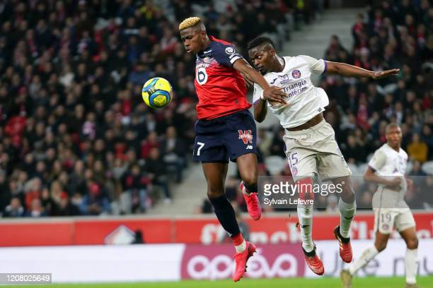 Lille's Victor Osimhen and Toulouse's Nicolas Isimat Mirin during the Ligue 1 match between Lille OSC and Toulouse FC at Stade Pierre Mauroy on...