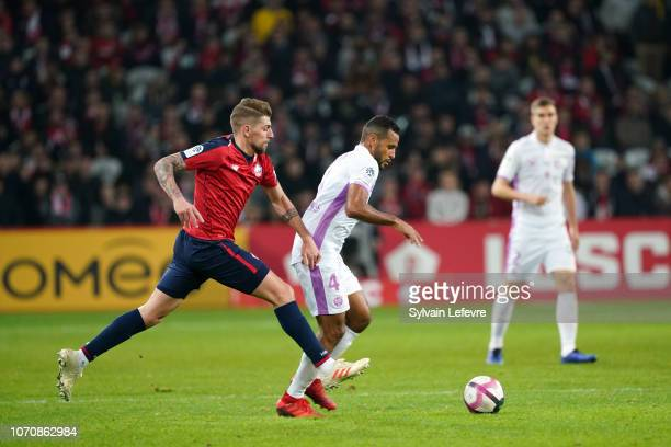 Lille's Xeka fights for the ball with Reims' JacquesAlaixys Romao during Ligue 1 match between Lille OSC and Stade de Reims at Stade Pierre Mauroy on...