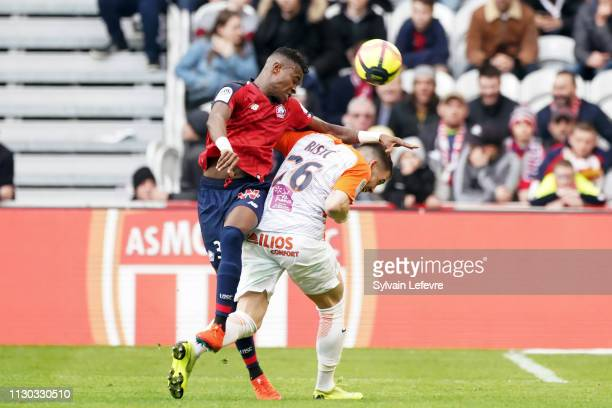 Lille's Youssouf Kone in action with Montpellier's Mihailo Ristic during the Ligue 1 match between Lille and Montpellier at Stade Pierre Mauroy on...