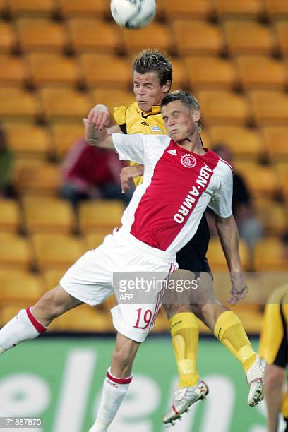 Start's player Marius Johnsen tackles Ajax Markus Rosenberg in the first round of the UEFA Cup match at Arasen Stadium in Lillestrom 14 September...