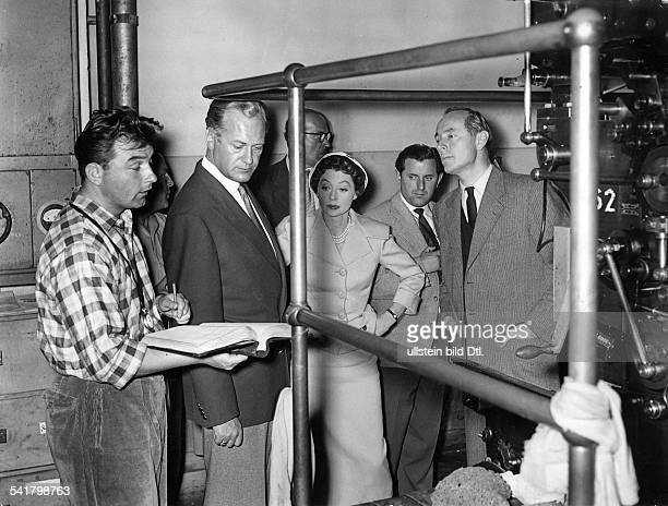 "Lilli Palmer, *-+, Actress, Germany - at the shooting to the film ""Devil in Silk"" with Curd Juegrens and the director Rolf Hansen - Germany, 1955"