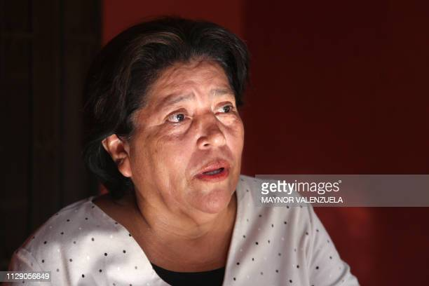 Lilliam Ruiz mother of imprisoned journalist Hanssel Vasquez speaks during an interview with AFP at her house in Managua on March 06 2019 Nicaraguan...