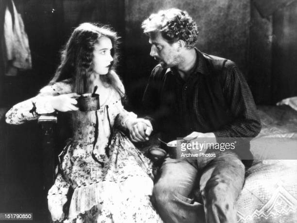 Lillian Gish and Lars Hanson hold hands in a scene from the film 'The Wind' 1928