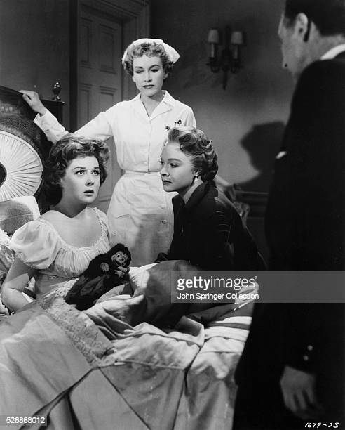 Lillian Roth is comforted by her mother Katie Roth and nurse Ellen in a scene from the 1955 film I'll Cry Tomorrow