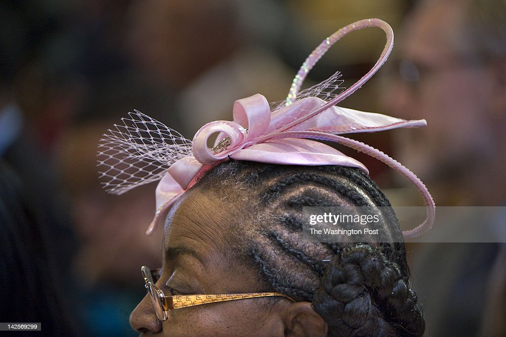 Lillie Alexander, 69, wears a dazzling pink hat to church on palm sunday at Zion Baptist Church in Washington, DC on April 1, 2012. Although wearing hats has been a long standing tradition for church going african american women, the newer generation is less likely to carry on the fashion statement.