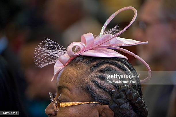 Lillie Alexander wears a dazzling pink hat to church on palm sunday at Zion Baptist Church in Washington DC on April 1 2012 Although wearing hats has...