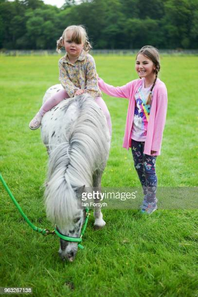 LilliGrace Deere sits on her horse with her friend Ayish Batalli 8 during the Duncombe Park Country Fair on May 28 2018 in Helmsley England Set in...