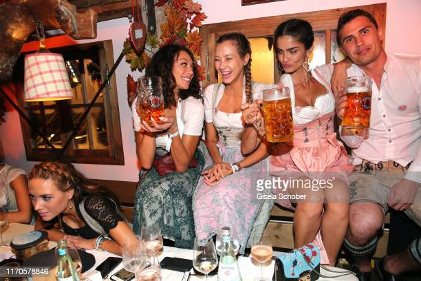 """Lilly Becker, Alessandra Meyer-Woelden, Shermine Shahrivar, Julian Maurer during the """"Wiesnbummel by CathyHummels"""" as part of the Oktoberfest 2019 at..."""