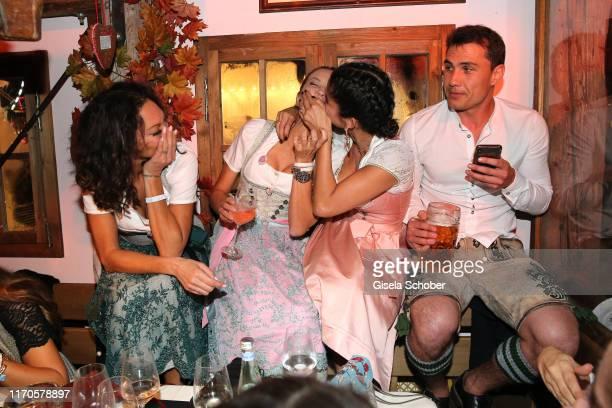 """Lilly Becker, Alessandra Meyer-Woelden, Shermine Shahrivar, Julian Maurer laugh during the """"Wiesnbummel by CathyHummels"""" as part of the Oktoberfest..."""