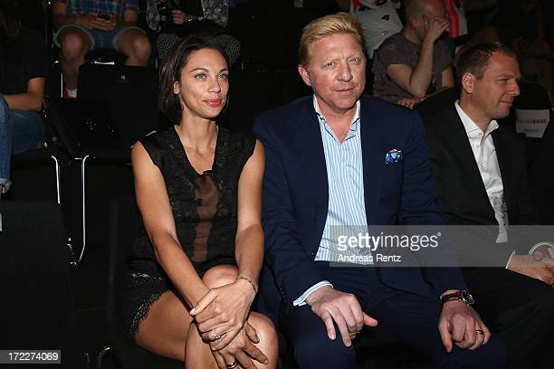 Lilly Becker and Boris Becker attend the Malaikaraiss Show during MercedesBenz Fashion Week Spring/Summer 2014 at Brandenburg Gate on July 2 2013 in...