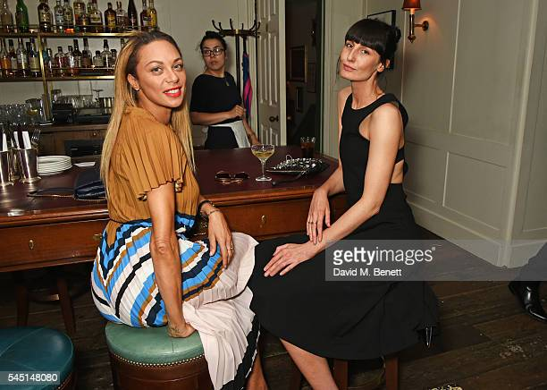 Lilly Becker and Erin O'Connor attend a private dinner hosted by Dylan Jones and JeanDavid Malat to celebrate artist Mike Dargas at Soho House on...