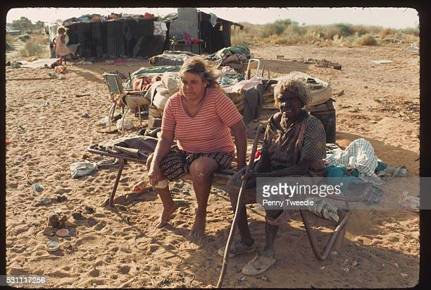 Lilly Billy a traditional Aboriginal land owner aged 99 sits with a friend at her camp Anna Creek Station Arnhem Land Northern Territory Australia