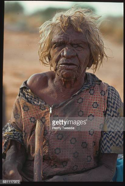 Lilly Billy a traditional Aboriginal land owner aged 99 stands in the street Anna Creek Station Arnhem Land Northern Territory Australia