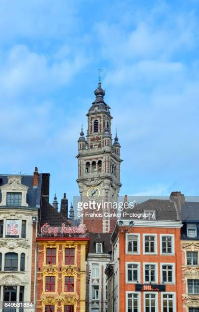 lilly cityscape with chamber of commerce building belfry rising behind old colorful houses, france - lille stock pictures, royalty-free photos & images
