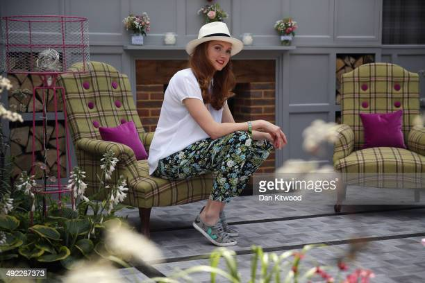 Lilly Cole poses during a photocall on the House of Fraiser stand at the 2014 Chelsea Flower Show at Royal Hospital Chelsea on May 19 2014 in London...