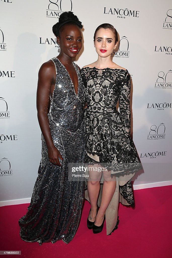 Lilly Collins and Lupita Nyong'o attend the Lancome 80th Anniversary Party as part of Paris Fashion Week Haute Couture Fall/Winter 2015/2016 on July 7, 2015 in Paris, France.